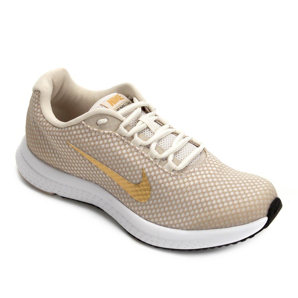 30adba48874 Tênis Nike Runallday Feminino - Bege e Dourado - Compre Agora